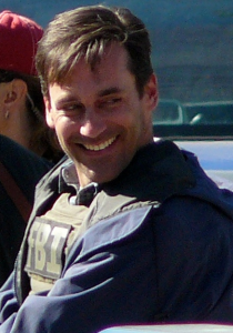 Actor Jon Hamm working on a film set.