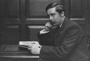 H. G. Wells reading one of his books.